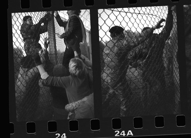 grabbing the bolt cutters Greenham Common